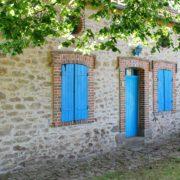 Het huisje met de blauwe luiken